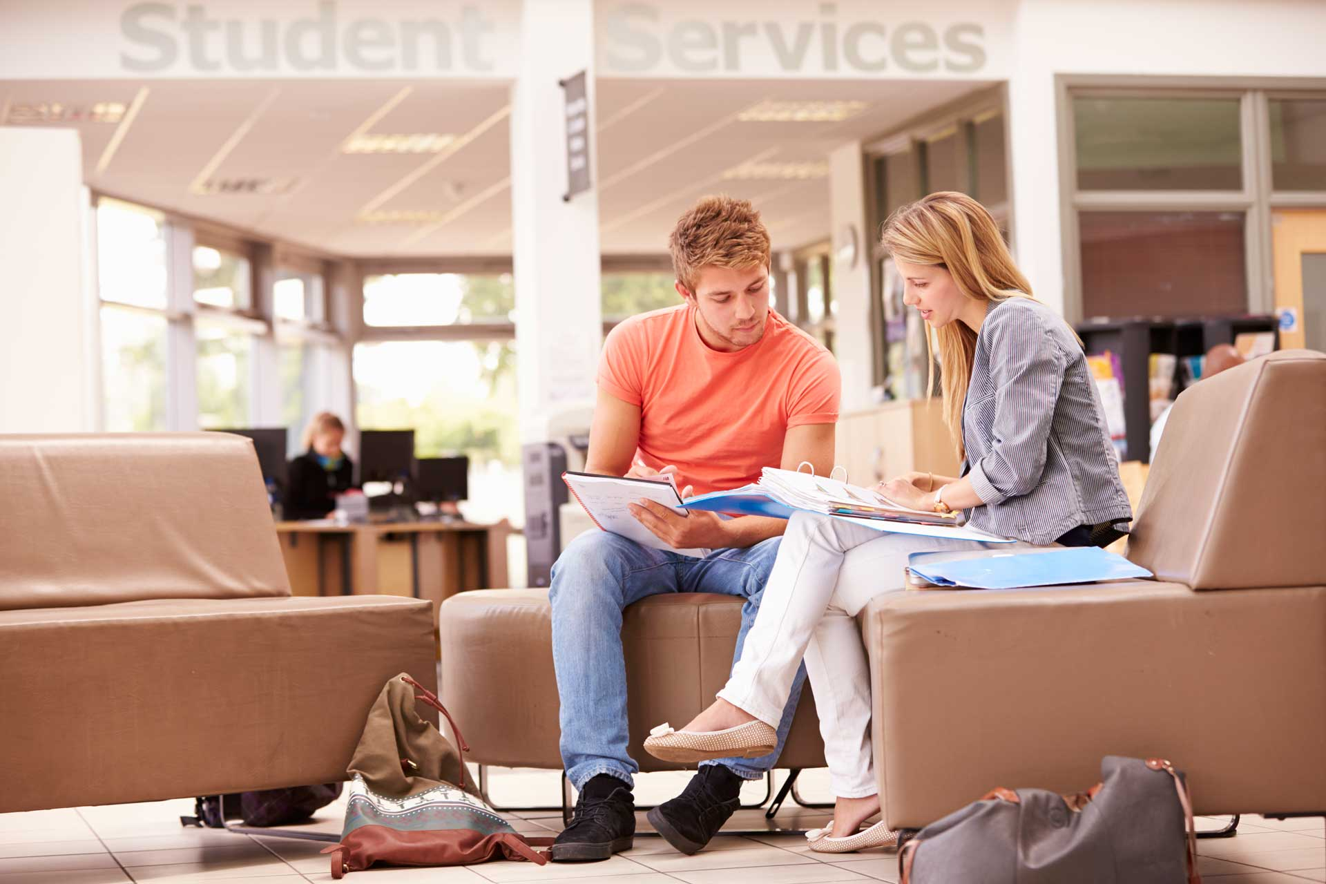 male-college-student-working-with-mentor-PEAAB3Z.jpg